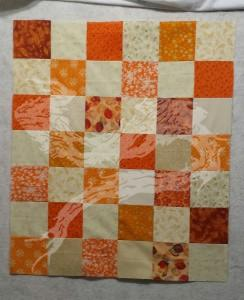 A twin to th e next one. It was suggested I make smaller baby quilts for new parents, as the smaller size makes it easier to swaddle a new born, then the quilt can be used for a car seat cover.